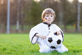 Little fan boy at public viewing of soccer or football game — Stock Photo