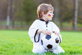 Little fan boy at public viewing of soccer or football game — Stockfoto