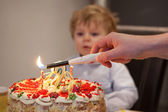 Little toddler blowing candles on his 2 birthday cake — Stock Photo