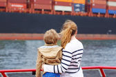 Little boy and mother watching ships on a ferry. — Stock Photo