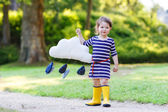 Cute toddler girl in yellow rubber boots — Foto de Stock