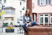 Beautiful woman posing at the camera in german city — Stock Photo