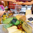Selling and buying cheese  on market place in Provence, France. — Stock Photo #51203439