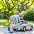 Two happy children playing with toy car — Stock Photo #51204079