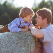 Young father and his little son having fun on yellow hay field i — Stock Photo #51204143
