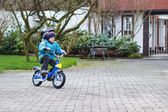 Little child of three years riding on bicycle in autumn or winte — Stock Photo