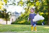 Cute toddler girl in yellow rubber boots and toy with rain drops — Stok fotoğraf