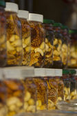 Honey with dried fruits in banks — Stock Photo