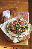 Flat bread with Cherry Tomatoes, Bacon and Chard on a wooden board — Стоковое фото