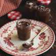 Chocolate mousse dessert in jars — Stock Photo