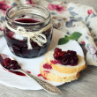 Cherry jam with walnuts and bread slices — Stock Photo