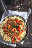 Couscous with sweet pepper, eggplants, courgette and shrimps — Stock Photo