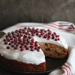 Christmas cake with dried fruits, nuts and fresh berries — Stock Photo