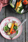 Baked Summer Vegetables on plate and skillet — Stock Photo