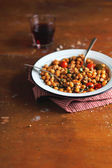 Chickpea with chicken, cherry tomatoes and lemon zest — Stock Photo