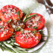 Baked tomatoes with cheese and rosemary - Foto Stock