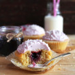 Blackcurrant cupcakes with coconut frosting — Stock Photo