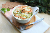Salad with cabbage, carrot, apples and pears with walnuts — Stock Photo