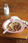 Homemade granola with dried fruits and nuts in a bowl — Stock Photo