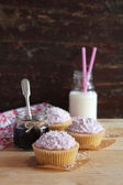 Three cupcakes with blackcurrant jam — Stock Photo