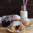 Royalty-Free Stock Photo: Three cupcakes with blackcurrant jam and coconut