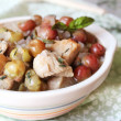 Hot pot of pork stew with red grape — Stock Photo