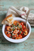 Portion of baked cherry tomatoes and roasted shrimps — Stock Photo