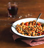 Portion of chickpea stew with cherry tomatoes — Stock Photo