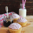 Valentines day cupcakes with berry jam, cream cheese icing and coconut — Stock Photo