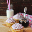 Stock Photo: Valentines day cupcakes with berry jam, cream cheese icing and coconut