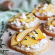 Bread slice with feta, thyme and nectarine — Stock Photo #36661603