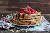 Stack of freshly baked pancakes with chocolate sauce — Stock Photo
