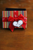 Valentine day present box and note heart-shaped card — Stock Photo