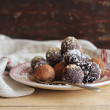 Homemade chocolate truffles with nuts, coconut and cocopowder — Stock Photo #38093595