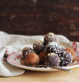 Homemade chocolate truffles with nuts, coconut and cocoa powder — Stock Photo