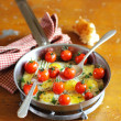 Sunny side up fried quail eggs with roasted cherry tomatoes — Stock Photo #38251445