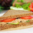 Stock Photo: Sandwich with rye brown bread, ripe tomatoes, cucumbers and tunfish for healthy snack