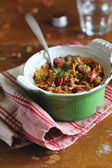 White cabbage stew with green lentil, carrot, onion and sausages in a pan — Stock Photo