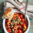 Stock Photo: Roasted cherry tomatoes and crispy shrimps with feta