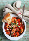 Roasted cherry tomatoes and crispy shrimps with feta — Stock Photo