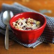 Stock Photo: Homemade granola with oats, chocolate chips and cranberry with fresh milk in a bowl
