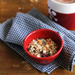 Homemade granola with oats, chocolate chips and cranberry with fresh milk in a bowl — Stock Photo