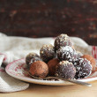 Homemade chocolate truffles with nuts, coconut and cocopowder — Stock Photo #39092579