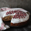 Easter fruit cake with meringue and fresh cranberry on a serving plate — Stock Photo #40014133