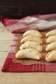 Easter small pies with apples, cinnamon, nutmeg, raisin and brown sugar sprinkles on a kitchen towel — Stock Photo