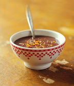Cup of hot milk and dark chocolate with cocoa, cinnamon and grated orange zest — Stock Photo