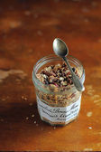Organic granola with toasted oats, roasted hazelnuts, dates, raisin and dried figs in a jar for healthy breakfast or snack — Foto Stock
