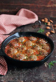 Traditional meatballs with tomato sauce, almond nuts, spices and fresh chopped dill in a pan — Stock Photo