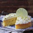 Pound cake with lemon, lime and freshly shredded coconut with cream cheese frosting — Stock Photo #44751583