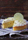 Pound cake with lemon, lime and freshly shredded coconut with cream cheese frosting — Stock Photo